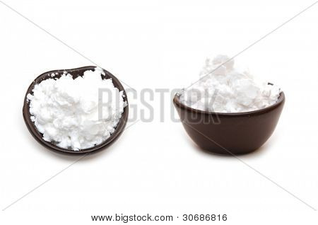 starch in a clay bowl on a white background