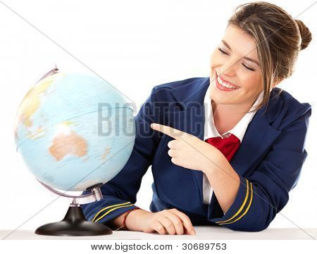 Air hostess pointing at the globe - isolated over a white background