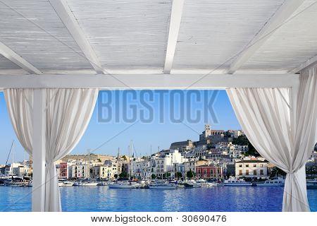 Ibiza town view from white gazebo in Mediterranean sea