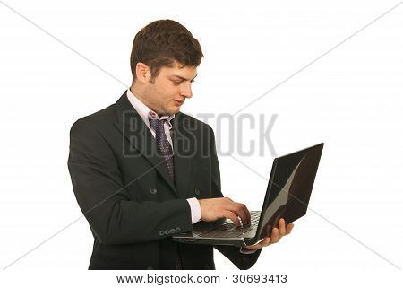 Businessman Typing On Laptop