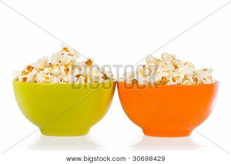 Popcorn in orange and green bowl