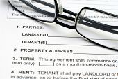 stock photo of rental agreement  - Close up of glasses on Rental agreement - JPG