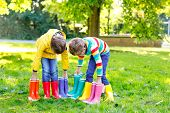 Two Little Kids Boys, Cute Siblings With Lots Of Colorful Rain Boots. Children In Different Rubber B poster