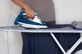 Clothing Ironing At Home. Young Girl Is Ironing Garments At Home. Female Hand Is Ironing Clothes, Cl poster