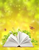 stock photo of reading book  - Book of nature on green background - JPG