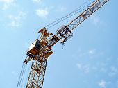 Crane. Construction Crane. Huge Crane Against Blue Sky. Self-erection Cranr. Tower Crane. poster