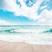 Sea Waves Crash On Sandy Beach. Wonderful Sunny Weather With Clouds On The Horizon. Emerald Water Be poster