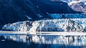 Rock Face/rockface Of Johns Hopkins Glacier With Floating Ice, Glacier Bay National Park And Preserv poster