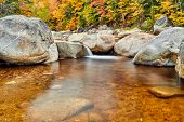 Swift River cascades at autumn in White Mountain National Forest, New Hampshire, USA. Fall in New En poster