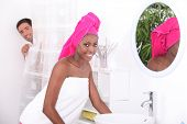 picture of mixing faucet  - portrait of a young woman in bathroom - JPG