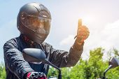 Man In A Motorcycle With Helmet And Gloves Is An Important Protective Clothing For Motorcycling Thro poster