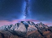 Milky Way Over Mountains At Starry Night In Autumn. Amazing Landscape With Alpine Mountains, Trees,  poster