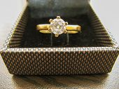 Gold Wedding Ring In Box On Closeup. Gold Engagement Ring.gold Diamond Ring . Womens Ring. poster