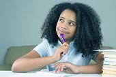 Black Schoolgirl Is Thinking About School Homework Doing Homework. poster