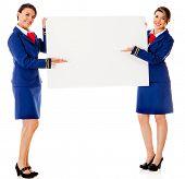 image of air hostess  - Air hostesses holding a banner  - JPG