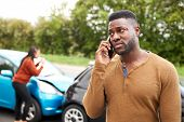 Male Motorist Involved In Car Accident Calling Insurance Company Or Recovery Service poster