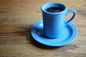 Black Coffee. Hot black coffee in a blue coffee mug. Restaurant Coffee.   poster