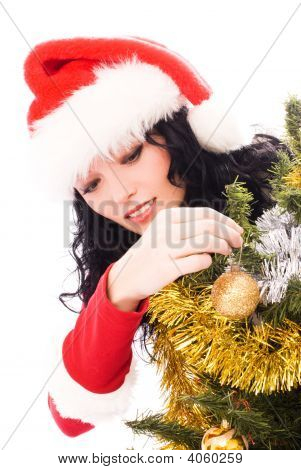 Beautiful Brunette Woman Decorating A Christmas Tree