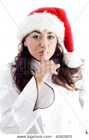 Pretty Chef Wearing Christmas Hat And Shushing With Finger