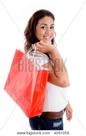 Side Pose Of Woman Holding Bag