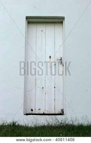 Neglected Old Rusted White Zinc Door