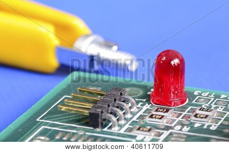 A red warning lamp in a computer hardware concept of troubleshooting and maintenance