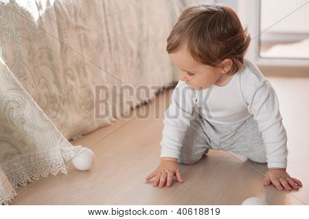 Little Baby Boy Playing With Silver Christmas Balls