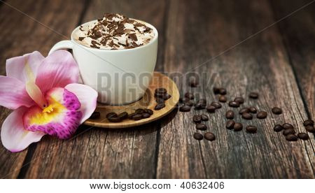 Cup of hot coffee and flower