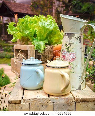 Tea Pots And Vegetables