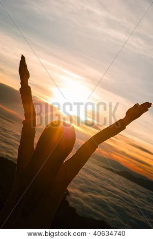 Silhouette Of Young Woman Over Sunset Light