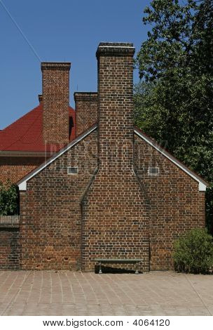 Colonial Brick Building And Chimneys