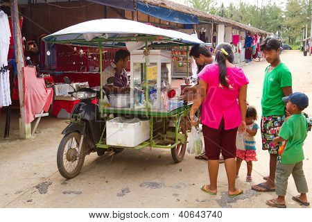 KHAO LAK, THAILAND - NOV 05: Unidentified people buying food from the mobile shop on the market in Khao Lak. This market is also tourist attraction in Phang Nga province, Thailand on Nov.05, 2012.