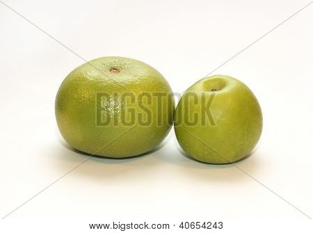 Solid Grapefruit And Green Apple On A White Background