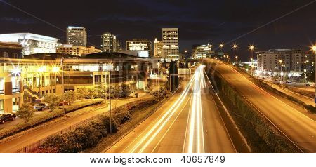 Tacoma Downtown At Night With Highway, Court House And Busines Center.