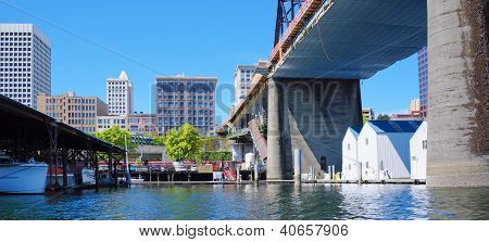 Tacoma Downtown City Marina With Houses And Large Bridge.