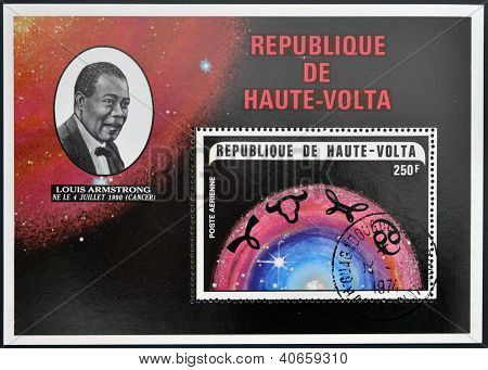A stamp printed in Republic of Upper Volta shows Louis Armstrong and the constellation of Cancer