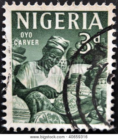 NIGERIA - CIRCA 1961: A stamp printed in Nigeria shows Oyo carver circa 1961