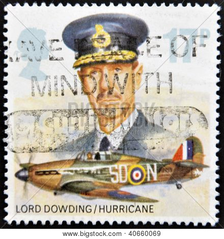 Stamp printed in Great Britain showing a Hawker Hurricane Fighter Plane