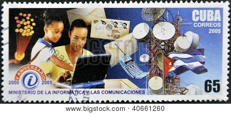 A stamp printed by CUBA shows to people using computer tower mobile 5 th anniversary of theMinistry