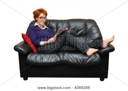 Red-haired Girl Is Laying On Sofa