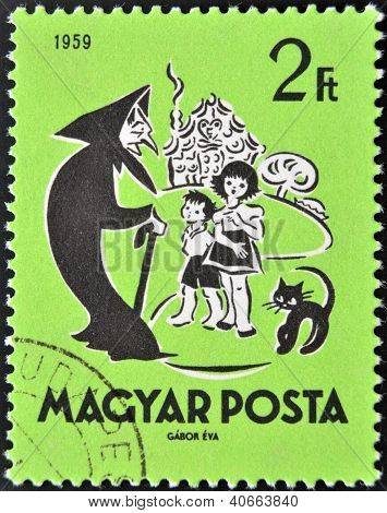 HUNGARY - CIRCA 1959: A stamp printed in Hungary showing Hansel and Gretel and the wicked witch