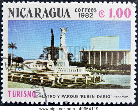 NICARAGUA - CIRCA 1982: A stamp printed in Nicaragua shows Ruben Dario Theater and park in Managua c