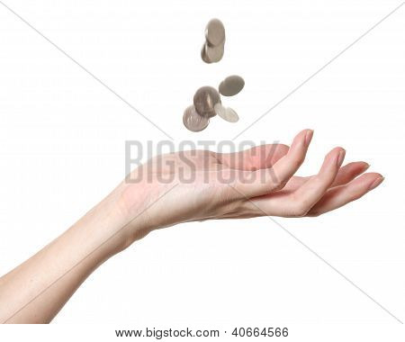 A Male Hand With Falling Coins