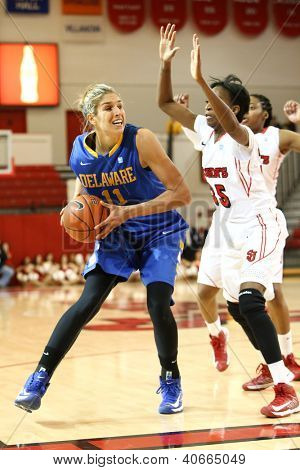 JAMAICA, NY-JAN 2: Delaware Blue Hens guard Elena Delle Donne (11) looks to shoot around St. John's Red Storm guard Shenneika Smith (35) at Carnesecca Arena on January 2, 2013 in Jamaica, New York.