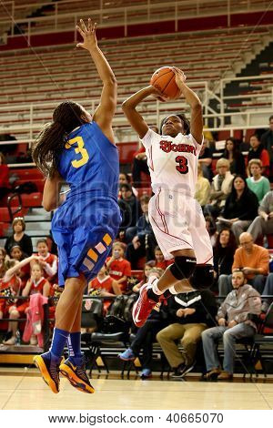 JAMAICA, NY-JAN 2: St. John's Red Storm guard Aliyyah Handford (3) shoots over Delaware Blue Hens guard Jaquetta May (3) at Carnesecca Arena on January 2, 2013 in Jamaica, Queens, New York.