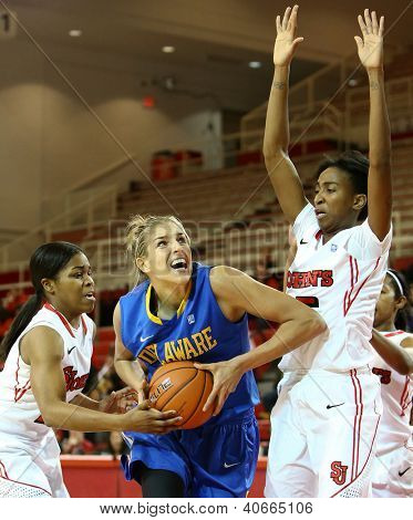 NEW YORK-JAN 2: Delaware Blue Hens guard Elena Delle Donne (11) shoots as St. John's Red Storm guard Shenneika Smith (35) defends at Carnesecca Arena on January 2, 2013 in Jamaica, New York.