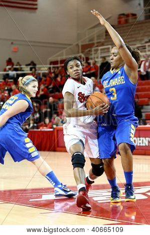 JAMAICA, NY-JAN 2: St John's Red Storm player drives to the net against the Delaware Blue Hens at Carnesecca Arena on January 2, 2013 in Jamaica, Queens, New York.