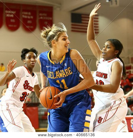 JAMAICA, NY-JAN 2: Delaware Blue Hens guard Elena Delle Donne (11) shoots around St. John's Red Storm guard Keylantra Langley (20) at Carnesecca Arena on January 2, 2013 in Jamaica, New York.