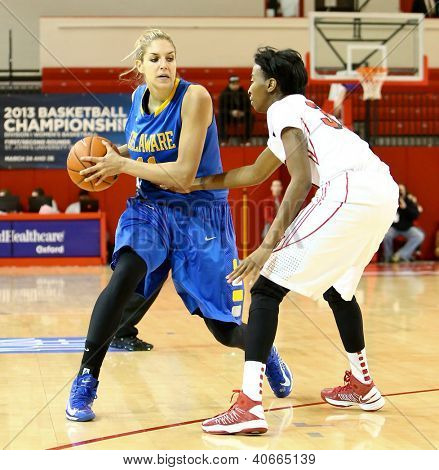 NEW YORK-JAN 2: Delaware Blue Hens guard Elena Delle Donne (11) looks to pass around St. John's Red Storm guard Shenneika Smith (35) at Carnesecca Arena on January 2, 2013 in Jamaica, New York.