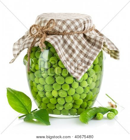 green peas in glass jar isolated on white background